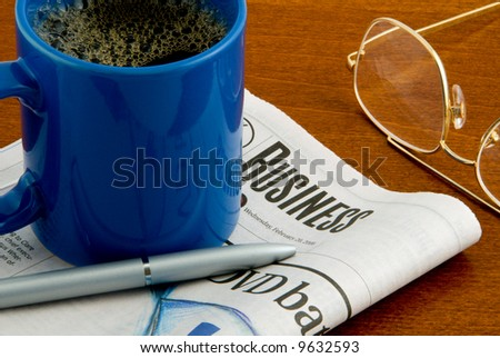 Newspaper, coffee, glasses & pen