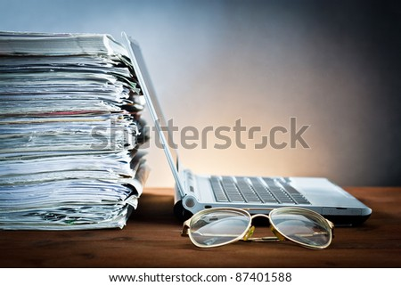 newspaper,eyeglasses and laptop