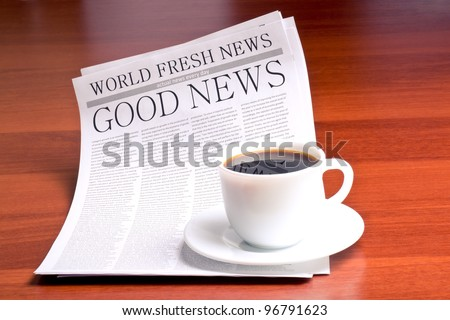 Newspaper GOOD NEWS and cup of coffee