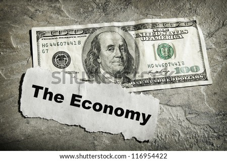 Newspaper headline with Economy text and cash