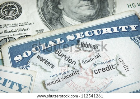 newspaper headlines and social security cards with cash