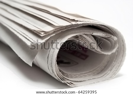 Newspaper on white background, close-up