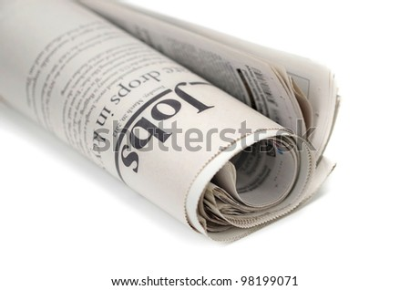 Newspaper on white background with shallow depth of field