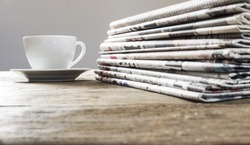 Newspaper on wooden table