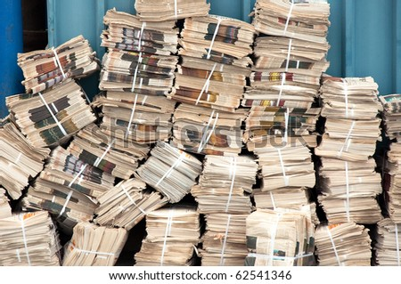Newspaper stack. Huge stack of old newspapers in the backyard - stock photo