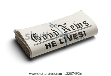 Newspaper With The Good News and the Headline He Lives printed on it Isolated On White Background