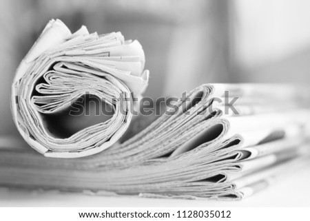 Newspapers. Folded and rolled papers with news (headlines, articles), side view                                #1128035012