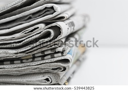 Newspapers folded and stacked #539443825