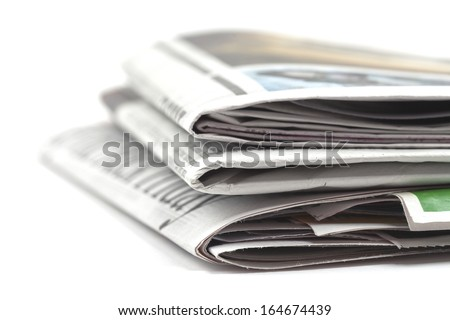 Newspapers folded, conceptual image for global communications