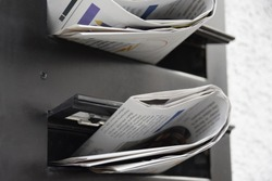 newspapers in a mailbox