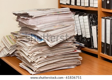 Newspapers isolated on desktop front of folders