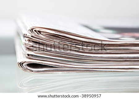 newspapers on a glass table