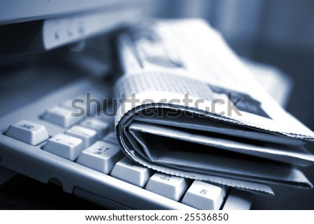 Newspapers on the computer keyboard close up
