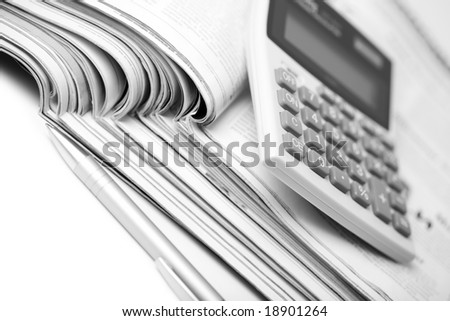 newspapers, pen and calculator. business background