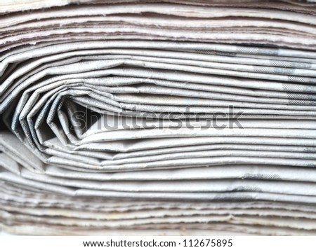 Newspapers, stack of newspapers close up