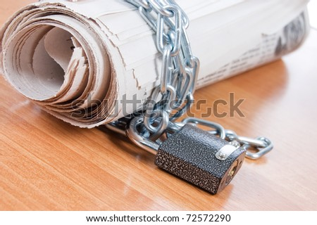 Newspapers with chains On a wooden table