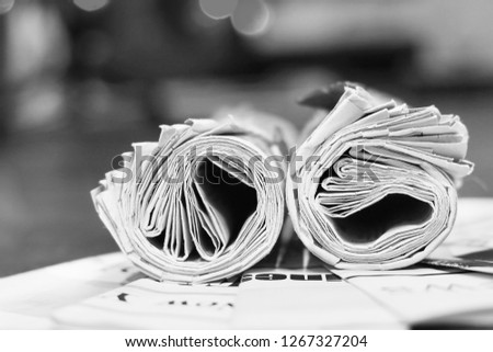 Newspapers with headlines and article on wooden table                               #1267327204