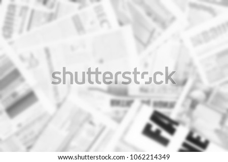 Newspapers with headlines and articles scattered on horizontal surface. Paper texture. Blurred background for news, announcement and advertising #1062214349