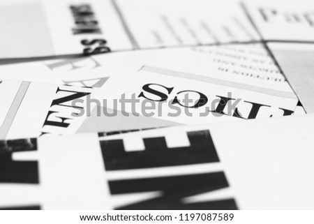 Newspapers with headlines and articles scattered on horizontal surface, side view,  background texture                        #1197087589