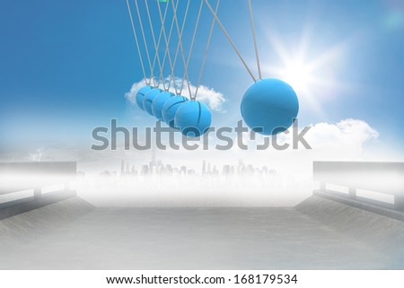 Newtons cradle above road to city