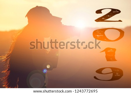 Newyear 2019 Silhouette young woman. Hipster girl photographer taking Photo future 2019 at sunrise Travel adventure in Destination. Nature Explore, outdoor mountain traveling. Travel woman at Sun.