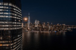 NewYork City and Jersey city waterfront skyline from Hudson River at night