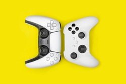 Next gen games controllers on yellow background.
