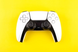 Next Gen  videogame console wireless wireless gamepad. Yellow background. Minimal style.