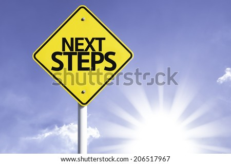 Next Steps road sign with sun background