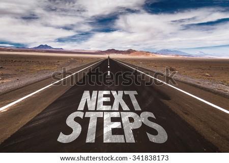 Next Steps written on desert road