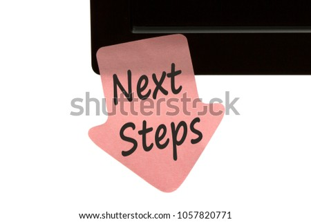 Next Steps written on reminder sticky note on monitor isolated on white background. Business Concept.