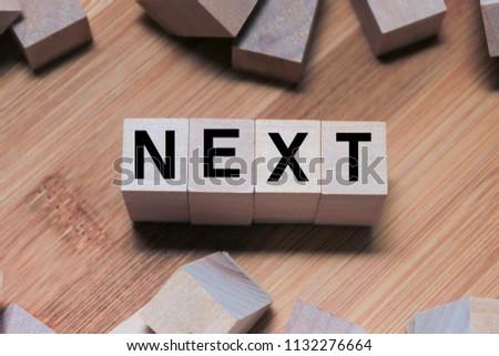 Next Word Written In Wooden Cube