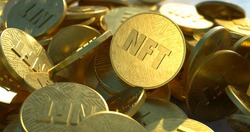 NFT golden coins in pile. Non fungible tokens dropped casually in a large pile, close-up shot. Embossed circuit design, shiny gold color with bright sunlight. Trendy cryptocurrency art coins.