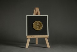 NFT non-fungible token crypto art on grey background. Pay for unique collectibles in art. NFT crypto art collectibles concept. Minimal concept