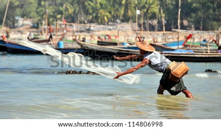 NGAPALI, MYANMAR - JANUARY 21: Burmese fishermen during the local Hta-Mane Festival at Bengal Bay on January 21, 2011 in Ngapali, Myanmar