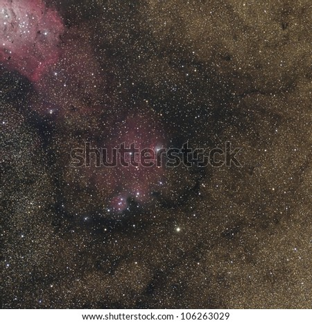 NGC 6559 and Part of the Lagoon Nebula in a Dense Star Field