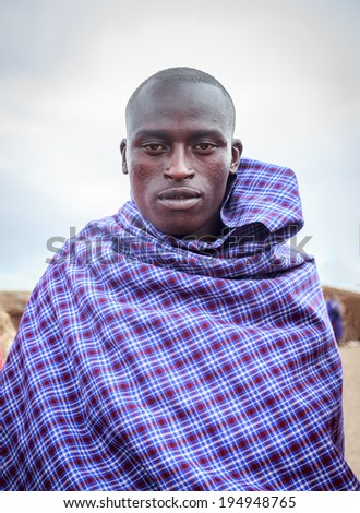 NGORONGORO, TANZANIA - DEC 29, 2013 :Young Masai acting for me to take picture ,when I asked him for one nice shot.