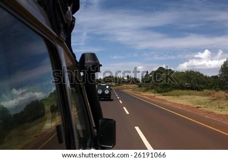 NGORONGORO, TANZANIA - JAN 4: Tourists car drive through Africa. January 4, 2009 NgoroNgoro, Tanzania.