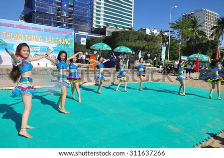 Nha Trang, Vietnam - July 14, 2015: Young girl dancers are performing a sport dance on the beach of Nha Trang city