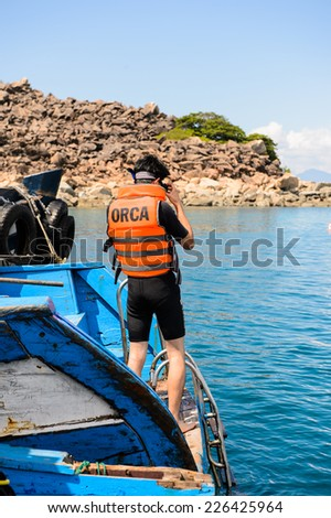 NHA TRANG, VIETNAM - SEP 30, 2014: Unidentified man on the boat in the South China Sea. South China Sea is 3,500,000 square kilometres