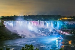Niagara Falls closeup panorama by night. Ontario, Canada.