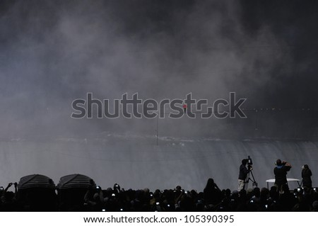 NIAGARA FALLS -JUNE 15: More than 120,000 people gathered from both sides of the border to watch  Nik Wallanda cross the Niagara Falls on a tightrope on June 15 2012 in Niagara Falls, Canada.