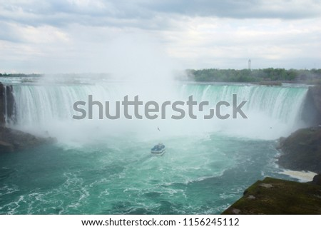 NIAGARA FALLS, ONTARIO, CANADA - MAY 20th 2018: Touristic boat on Horseshoe Falls, also known as Canadian Falls #1156245112