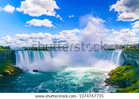 NIAGARA FALLS - The amazing Niagara Falls is renowned for its beauty and is the collective name for three waterfalls that straddle the international border between Canada and the USA. #1374767735