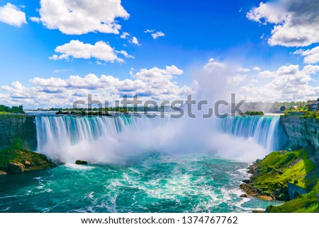 NIAGARA FALLS - The amazing Niagara Falls is renowned for its beauty and is the collective name for three waterfalls that straddle the international border between Canada and the USA. #1374767762