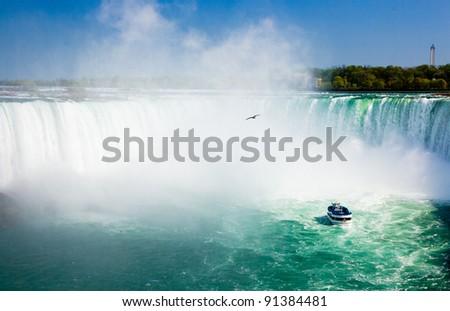Niagara Falls with tourist boat - stock photo