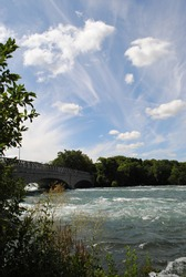 Niagara River Rapids with Bridge to Goat Island and Dramatic Clouds