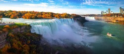 Niagara waterfall the big water fall between USA and Canada with Autumn and boat this immage can use for travel, waterfall, nature and united states of America concept