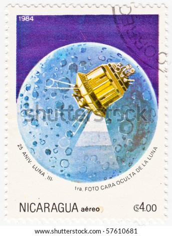 NICARAGUA - 1984: A stamp printed in Nicaragua shows an image of Luna 3 over the moon for the 25 Anniversary of the Soviet space probe, circa 1984