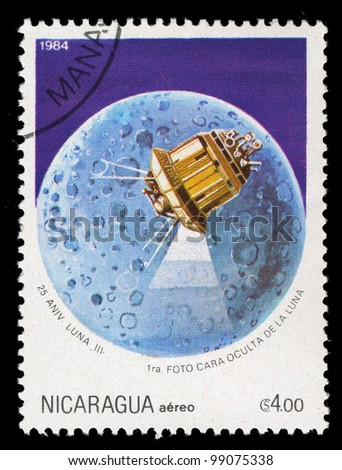 NICARAGUA - 1984: A stamp printed in Nicaragua shows Luna 3 over the moon, circa 1984